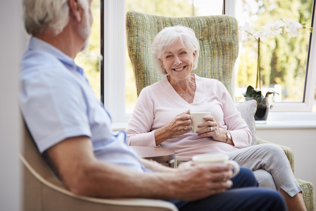 Two independent living residents socialize in independent living villa